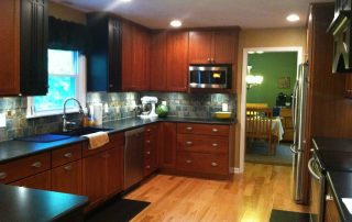 Cherry wood cabinets installed in kitchen